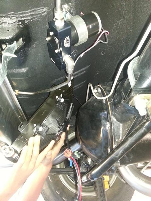 Transmission cooler mount: Under-car or Radiator?